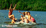© Photos.com Group of children playing in water. Many areas of Canada experienced very high temperatures in July.