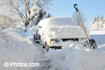 © Photos.com. Trucks buried in snow.  February storm recorded heavy snowfall in Quebec and Atlantic Canada.